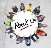 People in Circle with 'About Us' — Stock Photo