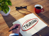 "Man Writing  Word ""Thursday"" — Fotografia Stock"