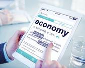 Man Reading the Definition of Economy — Stock Photo