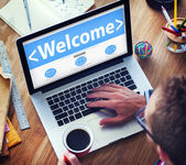 Man Using laptop with Welcome — Foto de Stock