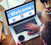Man Using laptop with Welcome — Stock Photo
