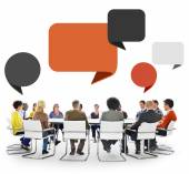 People in Meeting with Speech Bubbles — Stock Photo