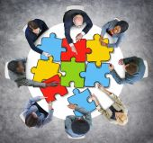 Business People with Jigsaw Puzzle — Stock Photo