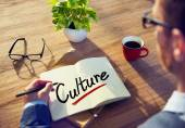 Businessman with Note About Culture — Stock Photo