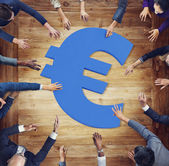 Business People Around Currency Symbol — Stock Photo
