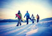 Snowboarders walk in mountains — Stok fotoğraf