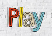 Play Word  on wall — Stock Photo