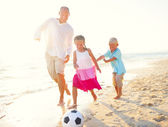 Father and kids playing football — Stock Photo