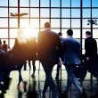 Commuters walking in airport — Stock Photo #71529451