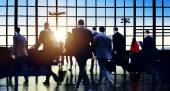 Commuters walking in airport — Stock Photo