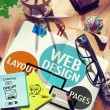 Постер, плакат: Messy table and Note with Web Design Concept