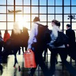 Commuters walking in airport — Stock Photo #71530731