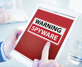 Man Using a Digital Tablet with Warning Spyware — Stock Photo