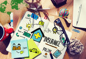 Messy office desk with Insurance Policy — Stock Photo