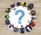 People at meeting with symbol — Stock Photo