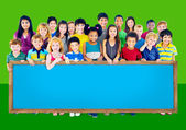 Group of Multiethnic children with blackboard — Stock Photo