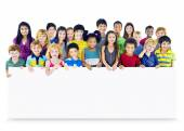 Group of Multiethnic children with empty board — Stock Photo