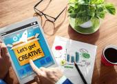 Man holding tablet with Let's Get Creative Concept — Stock Photo