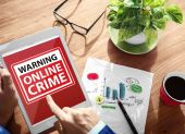 Hands holding tablet with Online Crime — Stock Photo