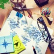 Messy office desk with Global Business — Stock Photo #72023309