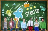People near chalkboard with Start Up Concept — Stock Photo