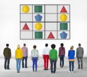 Gente diversa y Sudoku — Foto de Stock