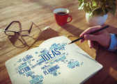 メモ帳で計画の実業家 — ストック写真