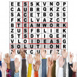 Crossword Puzzle Words and hands — Stock Photo #74709137