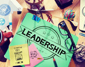 Messy office desk with Leadership Concept — Stock Photo