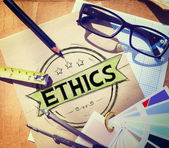 Ethics word on paper and workplace — Stock Photo