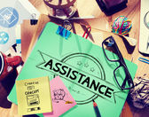 Messy office desk with Assistance Concept — Stock Photo