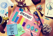 Messy office desk with Strategy Concept — Stock Photo