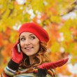 Portrait of beautiful attractive young woman in red beret talkin — Stock Photo #55534745