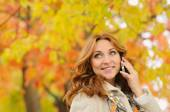 Portrait of beautiful attractive young woman talking on the phon — Stock Photo