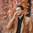 Portrait of attractive stylish young man speaking on the phone i — 图库照片 #56005207