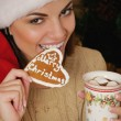 Portrait of beautiful smiling young woman with cookies near Chri — Stock Photo #57927867