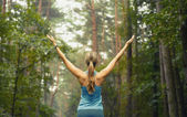 Healthy lifestyle fitness sporty woman early in forest area — Stock Photo