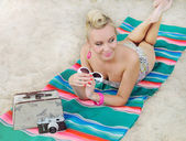 Attractive woman lying on the beach with vintage colorful detail — Stock Photo