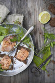 Starters with salmon butter seeds lemon and green herbs on complete rye bread — Stock Photo