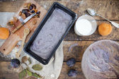 Food composition with fruits plum cake making of in rustic background — Foto de Stock