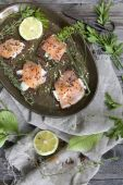 Starters with salmon butter seeds lemon and green herbs on complete rye bread — Stock fotografie