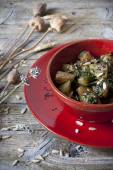 Roasted japanese turnips with leaves and seed on red bowl on rustic background — Stock Photo