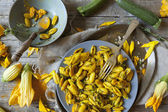 Summer flowers pasta with seed, petals and zucchini flowers with yellow spices — Stock Photo