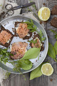 Starters with salmon, butter and sesame seed on rye bread on vintage tray — Stock Photo