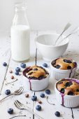 Three french clafoutis with blueberries and cherries on ceramic ramekins on rustic white vintage background — Stock Photo