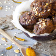Homemade rustic muffins with pumpkin chocolate and oat flakes on bowl — Stock Photo #60589315