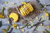 Homemade double rustic biscuits stuffed with pumpkin cream on wooden background with old scissor and pumpkin peels — Stock Photo