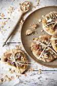 Homemade rustic gift cookies with bio figs and almond slices with seed on plate wooden table — Stock Photo