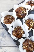 Rustic muffins with pumpkin chocolate and oat flakes on baking tray — Stock Photo