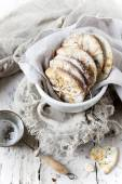 Homemade alternative cookies on bowl on white wooden table with vintage strainer and frayed cloth — Stock Photo